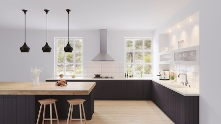 View into a kitchen with black base units