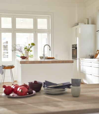 a white kitchen with an kitchen island
