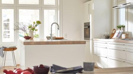 View into a modern, white kitchen