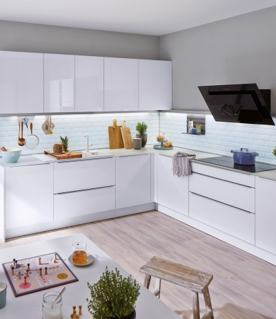A modern kitchen in white, in the practical L shape