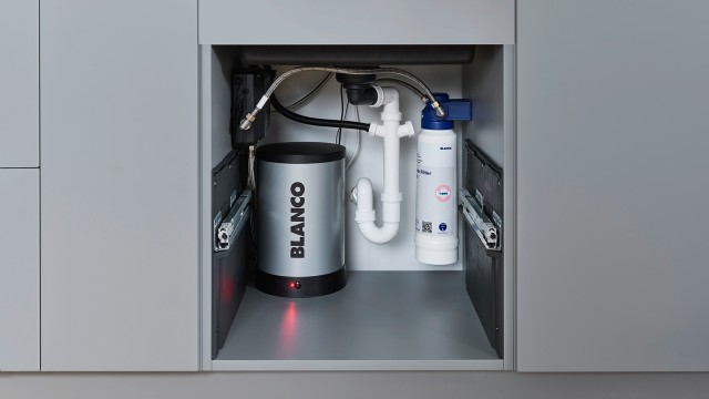 There is enough room in the base cabinet for a waste management system