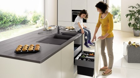 mother and daughter at cleaning up their kitchen island