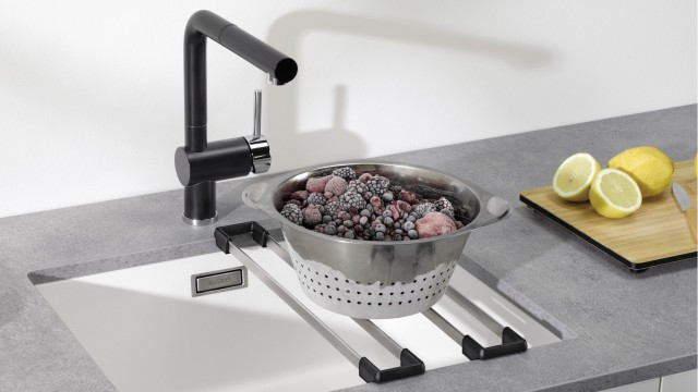 Simply place top-rails on the sink and set down sieves, pots or pans.