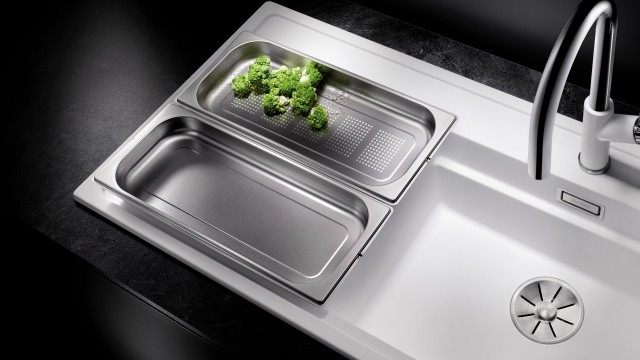 The spacious drainer also means that you won't need to put hot containers down on the worktop