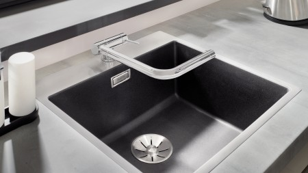 A mixer tap for a window-facing sink