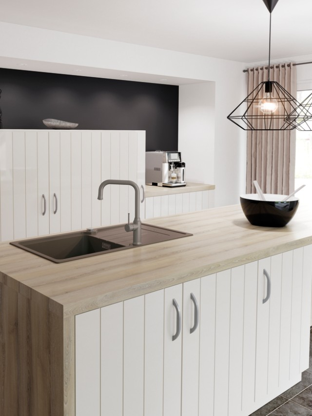 Scandinavian-influenced country-house kitchens use wooden elements to foster a warm atmosphere.