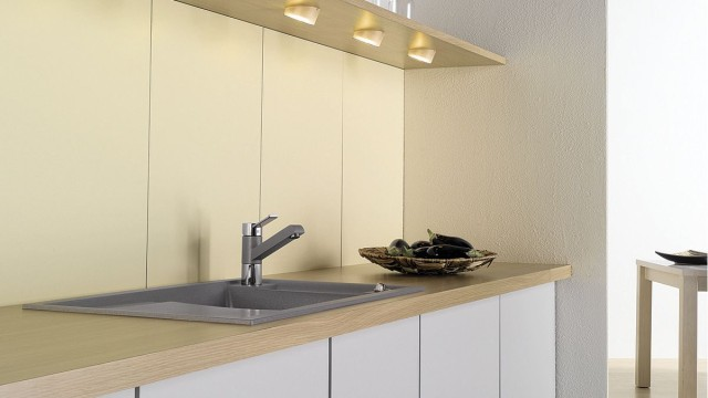 Adding lighting to the upper cabinets ensures plenty of light even in small kitchens.