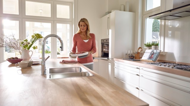 A raised sink ensures ergonomic comfort in the kitchen.