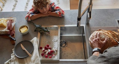 A son watches his father by the sink