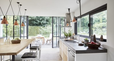 a modern kitchen with an open view into the back yard