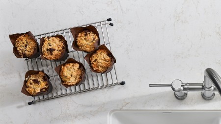 Bake muffins and cookies easily with a white farmhouse kitchen sink