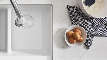 Prepping your ingredients is super easy with a white BLANCO IKON farmhouse kitchen sink