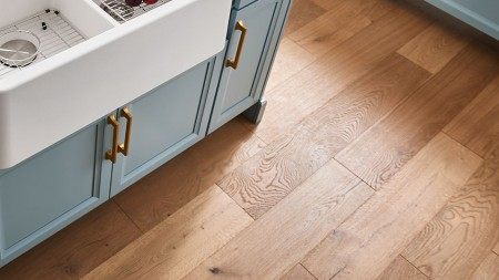 Wood floors are a must in a modern farmhouse kitchen. You can choose to leave the floors unfinished