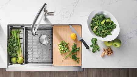 A deep farmhouse sink and the right accessories will optimize your kitchen workstation.
