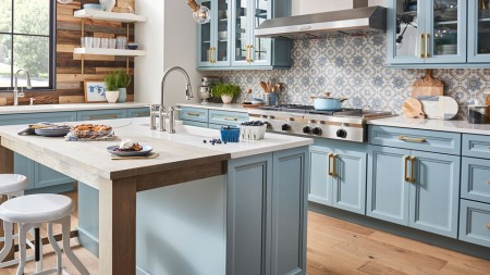 Farnhouse enthusiasts can wind down in this cozy, light blue kitchen island