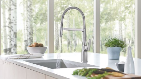 A kitchen faucet is a statement piece that grabs attention and creates a focal point