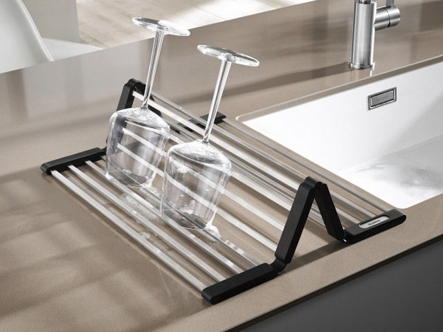 Folded up to create a zig-zag shape, the grid provides a secure drying area for delicate glasses