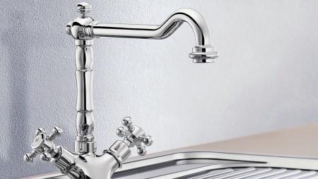 Dual-lever mixer taps