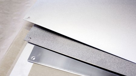 Three stainless steel surfaces in comparison