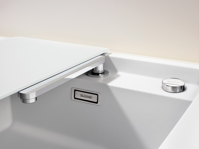 The ALAROS in white Silgranit Ideal for bright kitchens and hidden retractable mixer taps