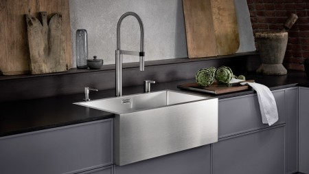 Stainless steel farmhouse-style sink meets history