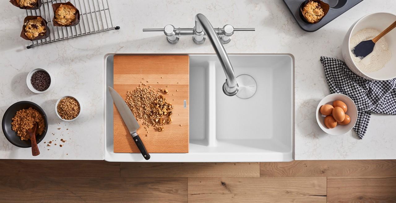 Ikon 33 1.75 Low Divide Farmhouse Kitchen Sink in metallic gray with Rivana Semi Pro Kitchen Faucet