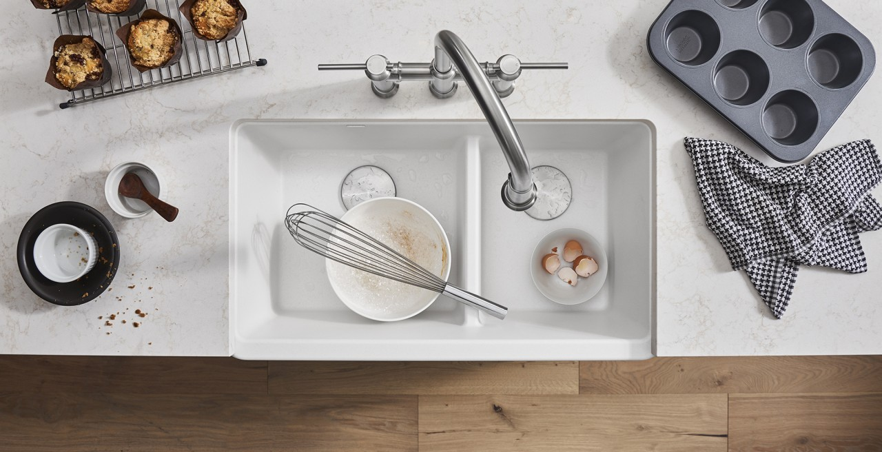 Ikon 33 1.75 Low Divide Farmhouse Kitchen Sink in white with Empressa Bridge Kitchen Faucet