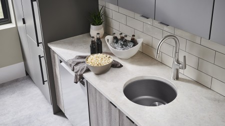 Rondo bar sink in cinder with Rivana bar faucet in PVD steel