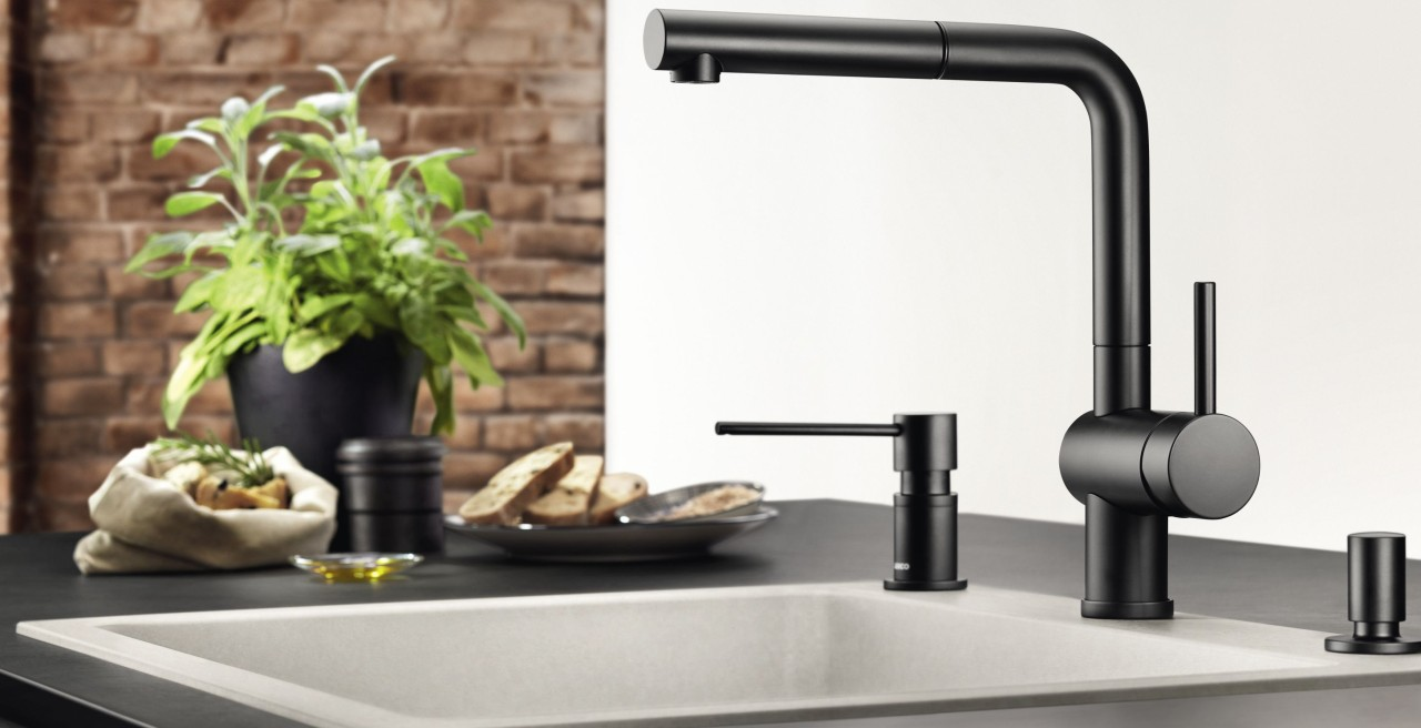 Black mixer taps mix well with concrete style sinks