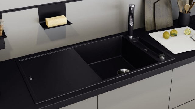 Mixer taps and sinks in the new SILGRANIT® PuraDur® black nestle perfectly into dark worktops.