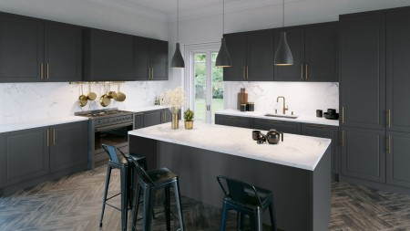 a beautiful black kitchen with silgranit sink
