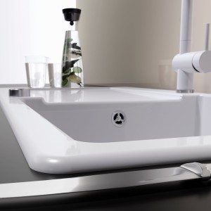 An inset or lay-on sink are inserted into the worktop cut-out and glued in place.