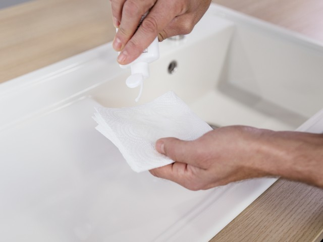 Shake the PuraPlus liquid and squeeze a little of the cleaning fluid onto a paper towel.