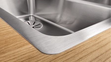 Stainless steel worktop in a wooden interior style