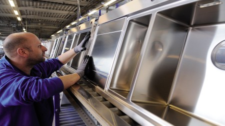 Stainless steel sinks on the assembly line