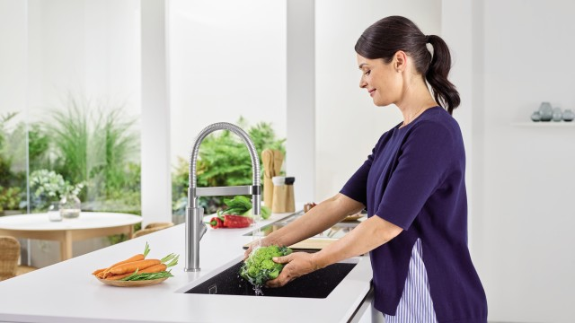 Washing vegetables in the sink